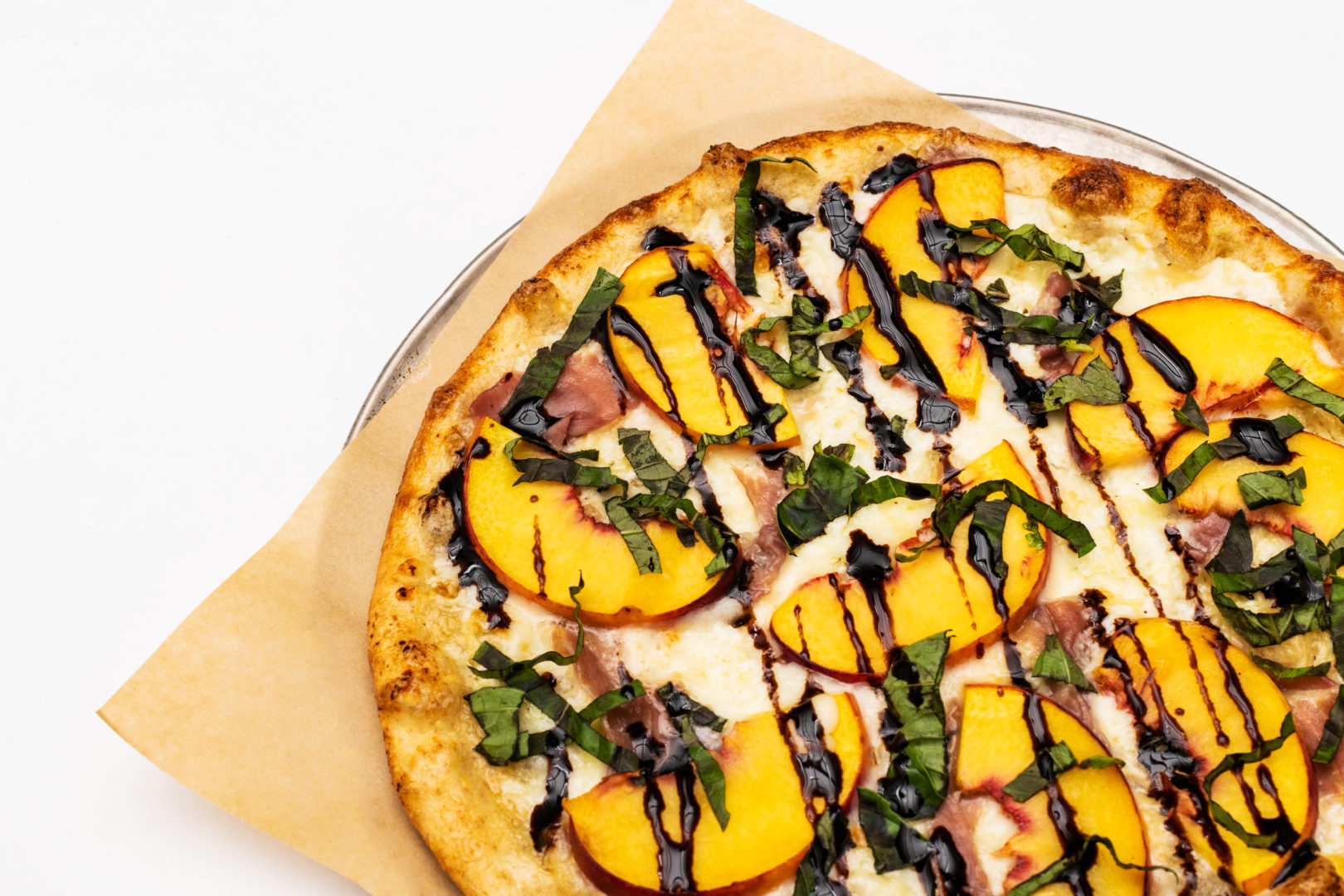 award-winning peach prosciutto pizza returns to your pie menu summer fast-casual foodies